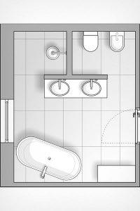 Mit einer Vorwandinstallation in T-Form wird dieses Bad in klare Zonen geteilt.